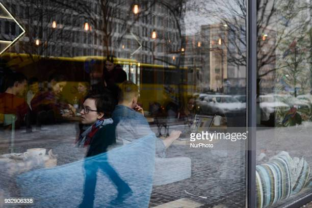 People are seen in the Etno cafe on Marszalkowska avenue in Warsaw Poland on March 16 2018 After a spell of warm weather temperatures in the country...