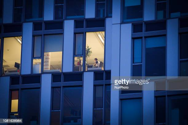 People are seen in the offices of Huawei Poland in Warsaw Poland on January 12 2018 On Friday a Chinese national an employee of Huawei has been...