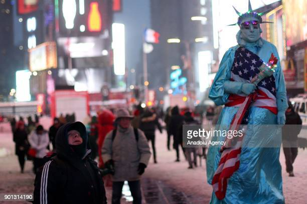 People are seen in Times Square during a snowstorm in Manhattan borough of New York United States on January 04 2018