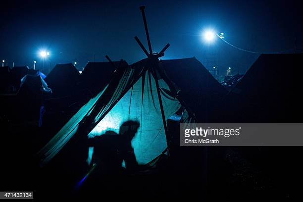People are seen inside a tent, setup in Tundikhel Park on April 28, 2015 in Kathmandu, Nepal. A major 7.8 earthquake hit Kathmandu mid-day on...