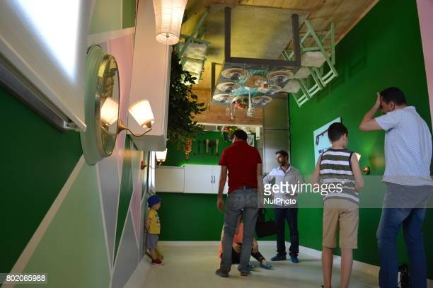 People are seen inside an upsidedown house at Cheerful Village in Ankara Turkey on June 27 2017 The 14th upsidedown house in the world which was...