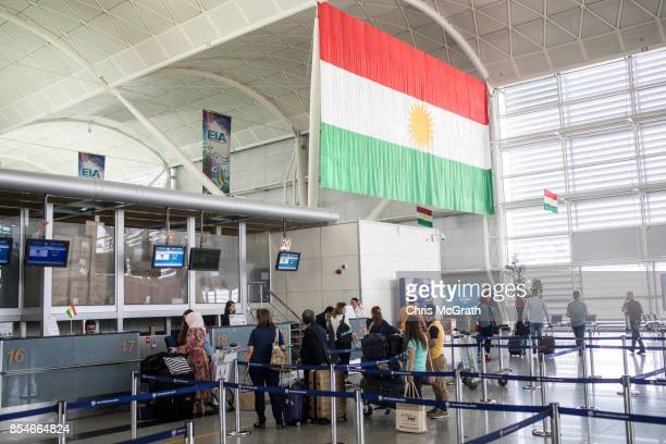 People are seen inside Erbil International Airport on September 27 2017 in Erbil Iraq In reaction to Kurdish leaders holding the September 25th...