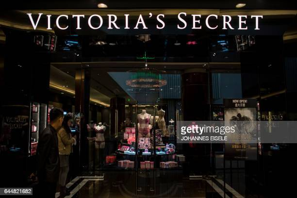 People are seen inside the newly opened Victoria's Secret shop in Shanghai on February 24 2017 The first Victoria's Secret store opened in China on...