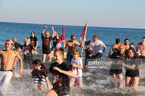 People are seen into the frigid water of Lake Ontario during the Toronto Polar Bear Dip organization in Toronto Canada on January 01 2017 People...