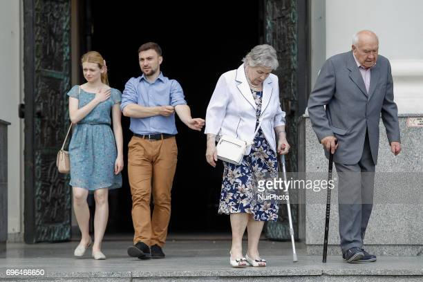 People are seen leaving the Saint Vincent de Paul basilica after mass on Corpus Christi day on 15 June 2017