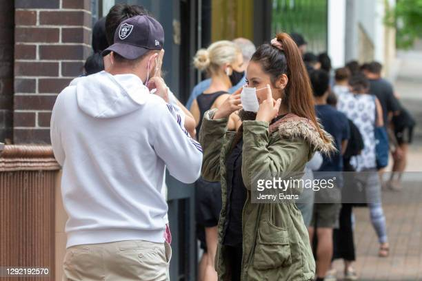 People are seen lining up at a COVID-19 testing centre at the East Sydney Community and Arts Centre in Darlinghurst on December 20, 2020 in Sydney,...