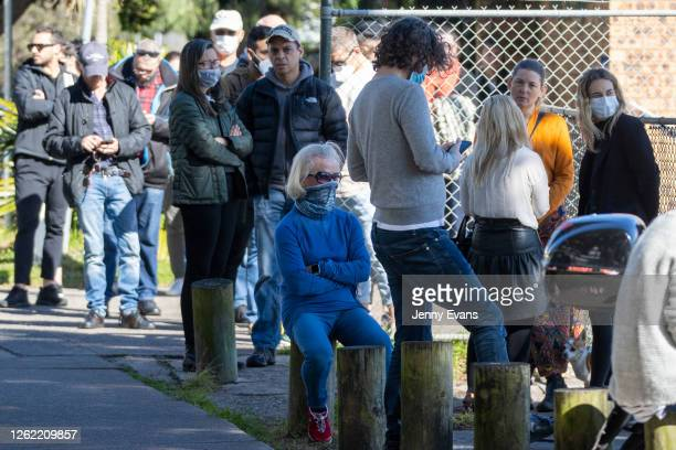 People are seen lining up at a popup COVID19 testing clinic in Rushcutters Bay on July 29 2020 in Sydney Australia Effective August 1 Queensland will...