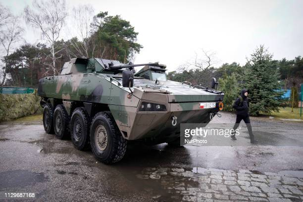 People are seen looing at an Armoured Personnel Carrier on display in Bydgsozcz Poland on March 9 2019 The local military base organized a public...