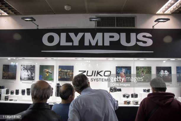 People are seen looking on at the Olympus new technologies systems during the festival Image Tech Photo vision 2019 is a big festival with large...
