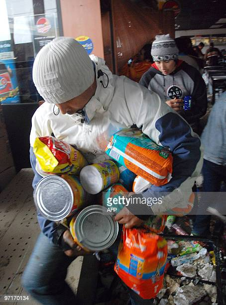 People are seen looting a supermarket in Penco 10 kms from Concepcion the day after a huge 88magnitude earthquake rocked Chile early morning killing...