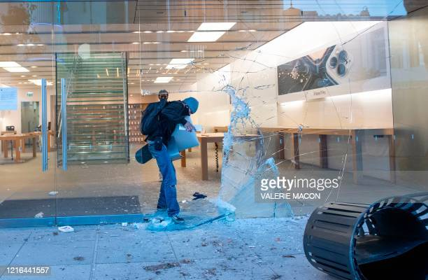 People are seen looting the Apple store at the Grove shopping center in the Fairfax District of Los Angeles on May 30 2020 following a protest...