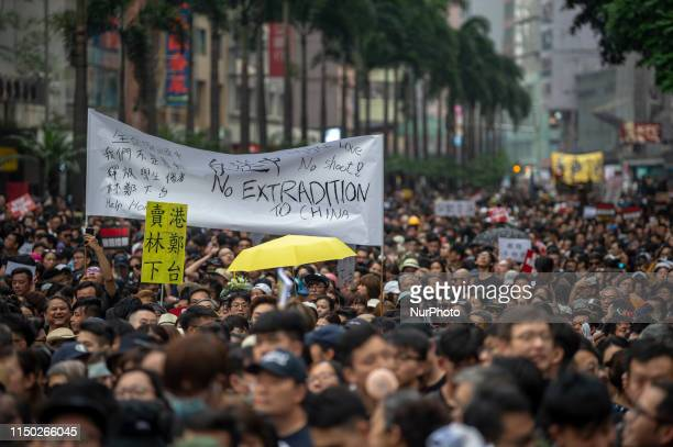 People are seen marching in the streets during a protest in Hong Kong, China. 16 June 2019. Tens of Thousands take to the streets of Hong Kong to...