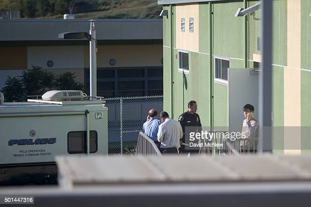 People are seen near a police mobile command center inside Edward R Roybal Learning Center as all Los Angeles city school are shut down after...