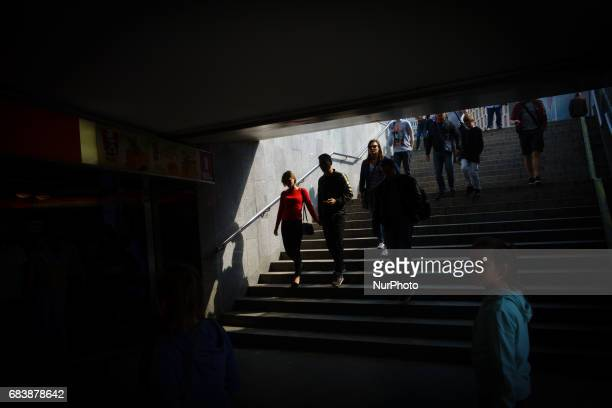 People are seen near Plac Defilad near the Palace of Science and Culture landmark in Warsaw Poland on 13 May 2017 The Palace of Culture was a gift...