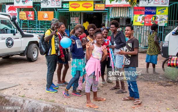 People are seen on a street ahead of an historical independence vote in the capital Buka on November 22 2019 The resourcerich Pacific archipelago of...