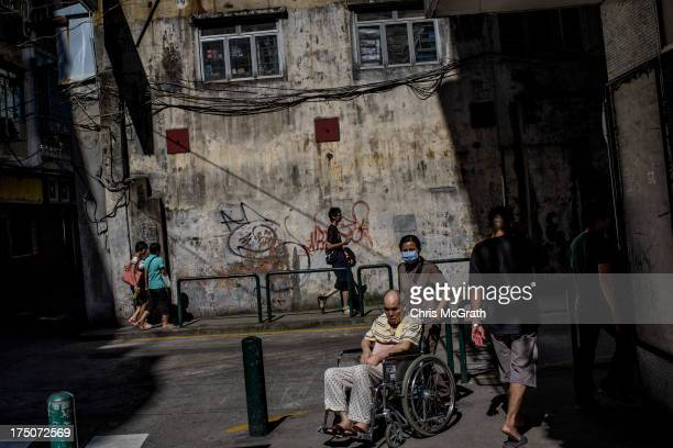 People are seen on a street in the residential district on July 29 2013 in Macau Macau Macau the only place in China with legalized casino gambling...