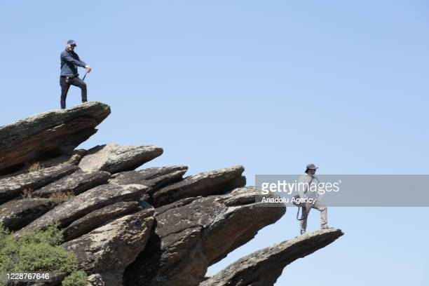 People are seen on basalt rocks in Kula district as Kula-Salihli Geopark, a global geological heritage recognized by UNESCO continue to be visited by...