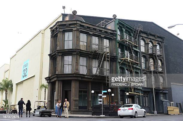 People are seen on site at the Paramount Pictures Studios in Los Angeles California on April 24 near a facade of an old New York neighborhood where...