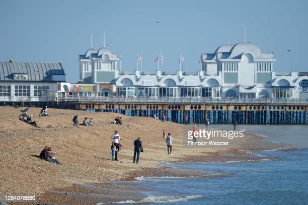 People are seen on the beach at Southsea on the first day of a new national lockdown on November 05, 2020 in Portsmouth, England. England enters...