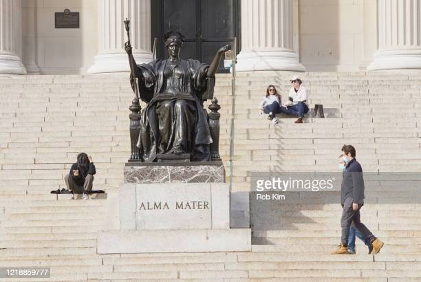 People are seen on the campus of Columbia University during the coronavirus pandemic on April 14 2020 in New York City ShelterInPlace and social...