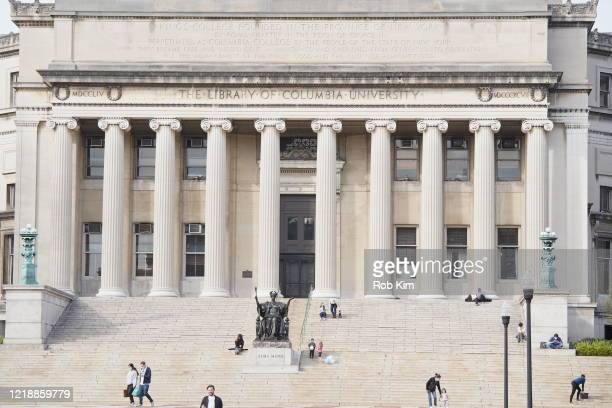 People are seen on the campus of Columbia University during the coronavirus pandemic on April 14, 2020 in New York City. Shelter-In-Place and social...