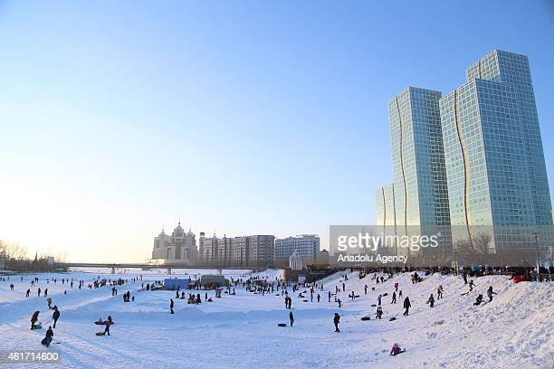 People are seen on the frozen Ishim River during the World Snow Day celebrations in Astana Kazakhstan on January 18 2015