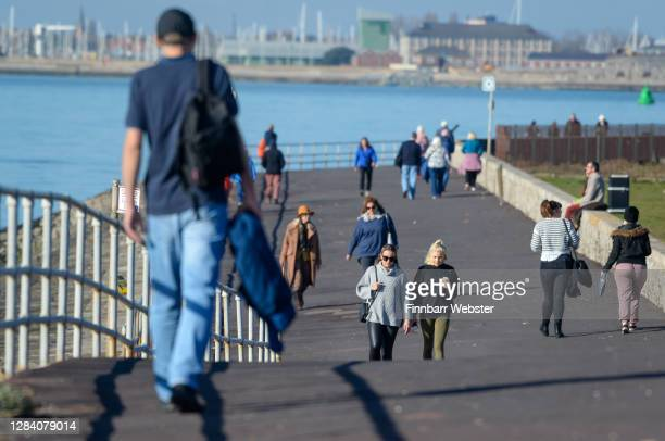 People are seen on the promenade at Southsea on the first day of a new national lockdown on November 05, 2020 in Portsmouth, England. England enters...