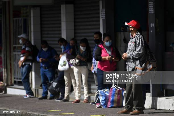 People are seen on the street after the government eased lockdown measures after five months of quarantine to fight the spread of the novel...
