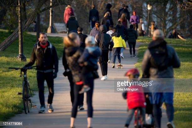People are seen out walking in Primrose Hill on March 25 2020 in London United Kingdom British Prime Minister Boris Johnson announced strict lockdown...
