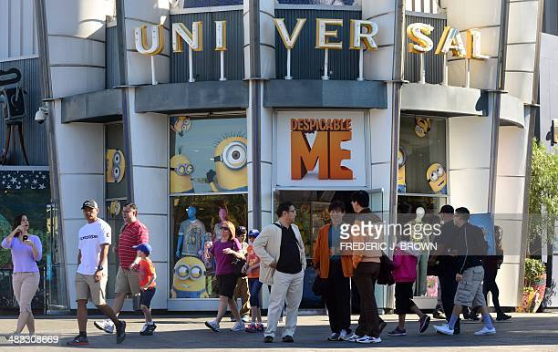 People are seen outsde the Despicable Me gift shop at Universal Studios where the Despicable Me Minion Mayhem attraction was still under construction...
