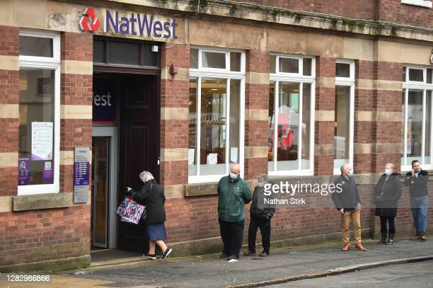 People are seen outside NatWest Bank on October 30, 2020 in Newcastle-under-Lyme, England. HSBC Chief Executive Noel Quinn said the bank will review...