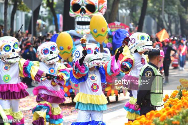People are seen participate during the traditional Skulls Parade as part of Day of the Dead celebrations at Reforma Avenue on 28 October 2017 in...