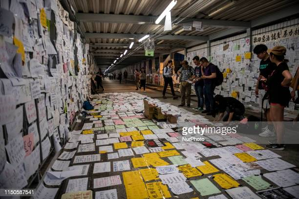 People are seen placing paper on the ground in Hong Kong China 18 June 2019