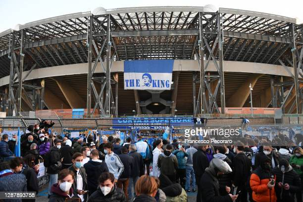 People are seen placing tributes in memory of Diego Maradona outside the stadium prior to the UEFA Europa League Group F stage match between SSC...
