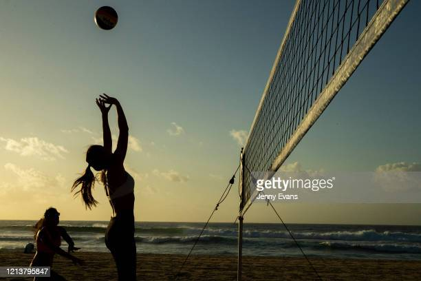 People are seen playing volleyball at Bondi Beach on March 21, 2020 in Sydney, Australia. The NSW Government has announced it will close Bondi Beach...