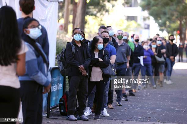 People are seen queuing to enter a mass COVID-19 vaccination hub on May 10, 2021 in Sydney, Australia. The mass vaccination centre at Sydney Olympic...