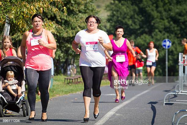 People are seen running on high heels during a competition in Myslecinek Park Bydgoszcz Poland on 27 August 2016