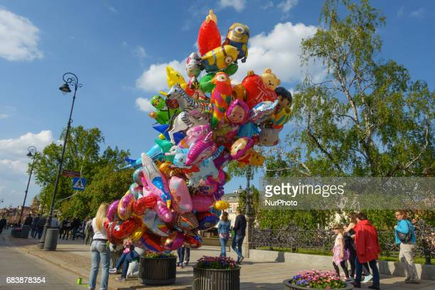 People are seen selling helium filled balloons in the Old Town of Warsaw Poland on 13 May 2017