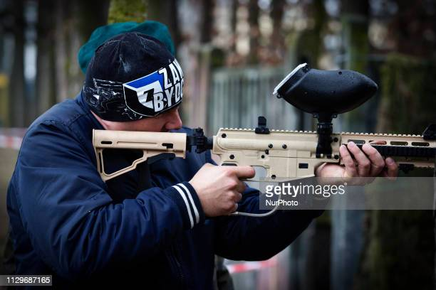 People are seen shooting paintballs at a shooting range at a military base in Bydgoszcz Poland on March 9 2019 The local military base organized a...