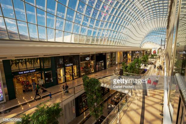 People are seen shopping at Chadstone Shopping Centre on October 28, 2020 in Melbourne, Australia. Lockdown restrictions in Melbourne lifted as of...
