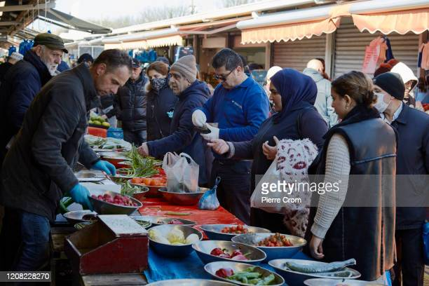 People are seen shopping at The Hague market one of the largest market in Europe amid the worsening COVID19 virus pandemic on March 25 2020 in The...