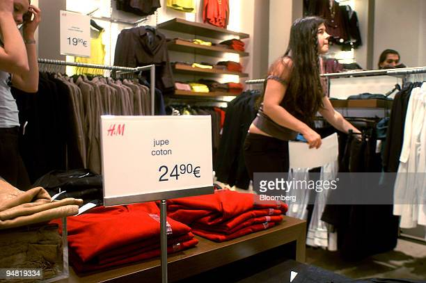 People are seen shopping at the HM store on Boulevard Haussmann in Paris France Thursday January 19 2006 Hennes Mauritz AB is set to lose its status...