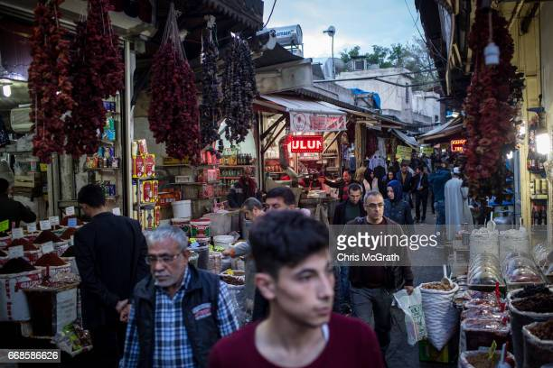 "People are seen shopping in a market in the old city on April 14, 2017 in Sanliurfa, Turkey. Campaigning by both the ""Evet"" and ""Hayir"" camps has..."
