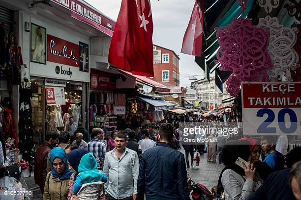 People are seen shopping in a market street in Eminonu on September 26 2016 in Istanbul Turkey Credit rating agency Moody's Investor Services...