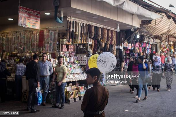 People are seen shopping on a street ahead of the upcoming referendum for independence of Kurdistan on September 23 2017 in Sulaymaniyah Iraq The...