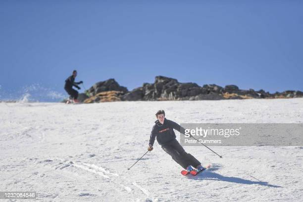 People are seen skiing on April 3, 2021 in Glencoe, Scotland. Temperatures are due to drop with snow expected in Northern Scotland on Easter Monday.