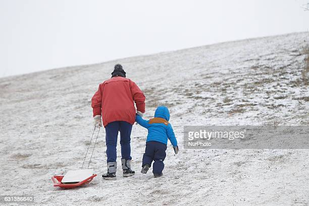 People are seen sledding from a small hill in Bydgoszcz Poland on 9 January 2017 Temperatures in the central part of Poland have reached minus 16...