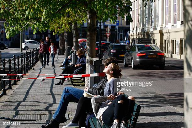 People are seen soaking up the sun in The Hague This year has seen record amounts of sun hours compared to previous years