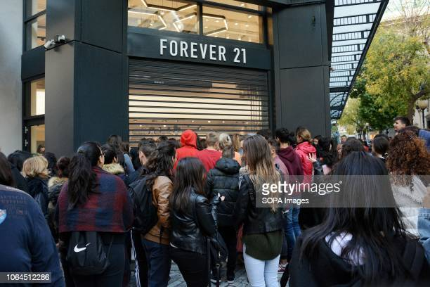 People are seen standing outside forever 21 shop as they wait for it to be opened, due to the Black Friday discount at the Ermou Street in Athens.