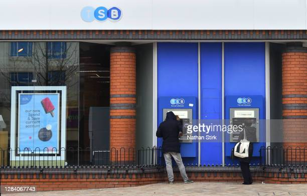 People are seen using the TSB Building Society cash points on November 05, 2020 in Stoke-on-Trent, Staffordshire, England.